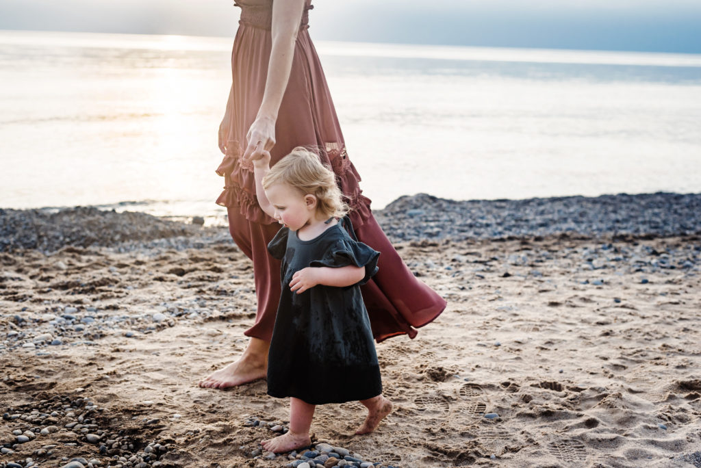 Family Photographer, Mother walking daughter by the ocean