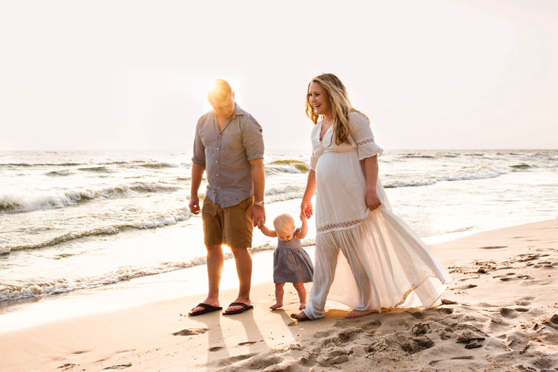 grand rapids michigan maternity photo family walking on the beach