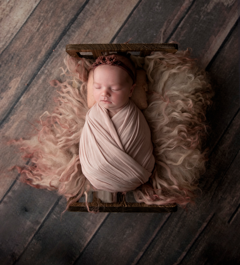 grand rapids michigan baby and newborn photographer baby sleeping in a bed