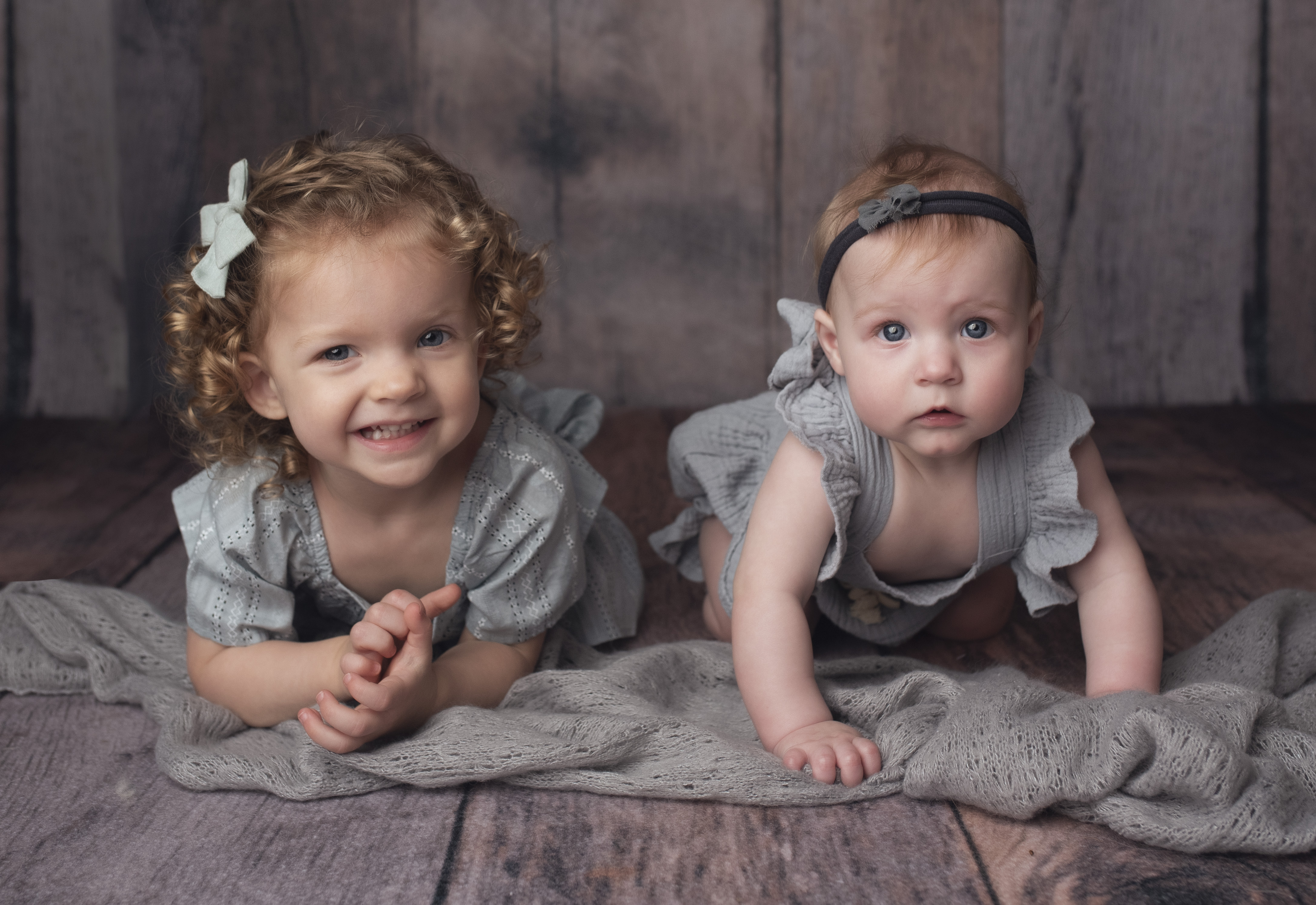 grand rapids milestone photography shoot 6 month sitter session girl with blue eyes